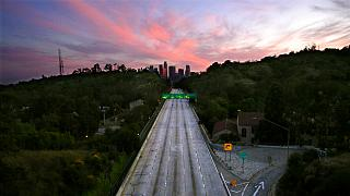 File: Empty lanes of the 110 Arroyo Seco Parkway that leads to downtown Los Angeles during the coronavirus outbreak in Los Angeles, California, April 26, 2020
