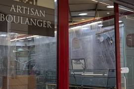 A bakery in Marseille has changed its interior in a bid to contain COVID-19 spreading. The counter is separated from the customers with plastic film. France. May 2020