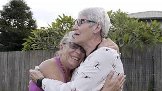 Christine Archer, right, and her sister Gail Baker cry as they are reunited in Bowraville, Australia