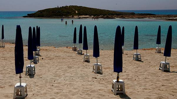 Rows of closed parasols on a nearly empty stretch of Nissi beach in Cyprus' seaside resort of Ayia Napa, a popular tourist destination, Wednesday, May 13 2020.