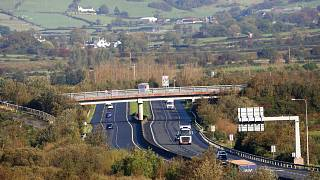 File - The M1 motorway crossing the Irish border near the town of Jonesborough, Republic of Ireland, looking across the border into Northern Ireland