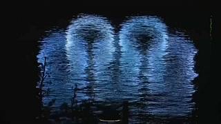 Olympics logo reflected on water