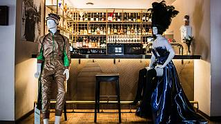 """Mannequins showcase designers' collections at restaurant """"Cosy"""" in Vilnius Old Town."""