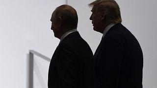 الرئيس الروسي فغديمير بوتين ونظيره الأمريكي خلال قمة 20 في اليابان. 2019/06/28