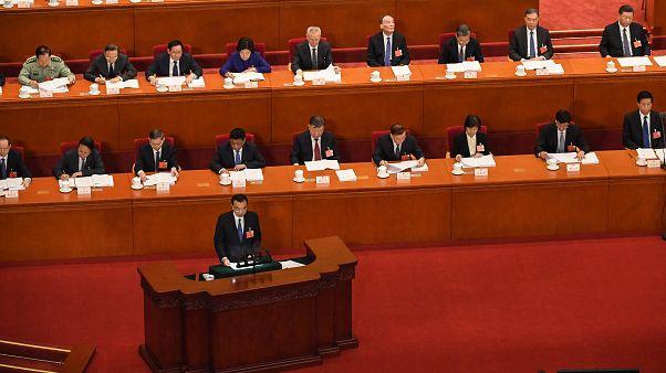 رئيس الحكومة الصيني لي كي تشيانغ رفقة رئيس الدولة شي جين بينغ