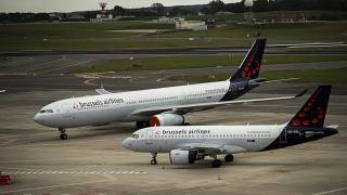 Planes from Brussels Airlines sit idle on the tarmac at Brussels Airport in Brussels, Tuesday, May 12, 2020.