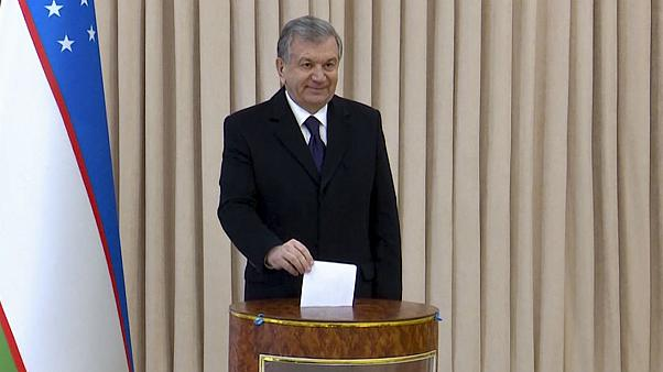 Uzbekistan's President Shavkat Mirziyoyev poses for a photo during the parliamentary elections at at a polling station in Tashkent, Uzbekistan, Sunday, Dec. 22, 2019
