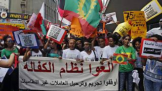 """Abolish the Kafala system. Stop trying to deporting illegal domestic workers,"""" during a rally to mark International Domestic Workers Day, in Beirut, Lebanon, Sunday, June"""