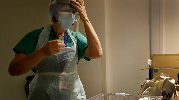 Nurse gets dressed in PPE, UK