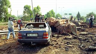 May 23, 1992 file photo shows the damage after a bomb blast killed anti-Mafia prosecutor Giovanni Falcone, his wife and three policemen