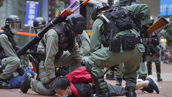 Riot police detain a protester during a demonstration against Beijing's national security legislation in Causeway Bay in Hong Kong