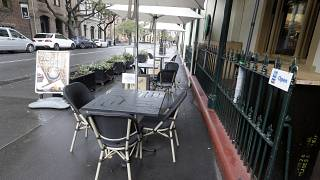 Tables go empty at a restaurant in Sydney, May 2020.