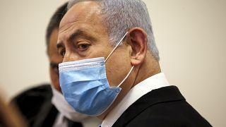 "Netanyahu said his head was ""held high"" as he began the graft trial"