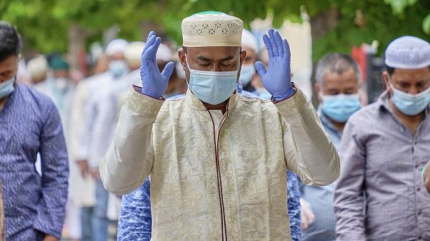 Muslims wearing gloves and face masks to prevent the spread of coronavirus attend prayers for Eid al-Fitr, the feast of breaking the fast that ends Ramadan.