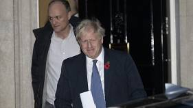 British Prime Minister Boris Johnson and his advisor Dominic Cummings, left, leave 10 Downing Street in London. 2019