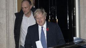 British Prime Minister Boris Johnson and his advisor Dominic Cummings, left, leave 10 Downing Street in London. 2019