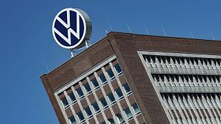 The Volkswagen logo stand on the top of a VW headquarters building in Wolfsburg, Germany