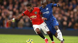 Manchester United's Fred, left, and Chelsea's N'Golo Kante battle for the ball