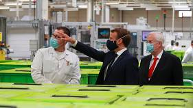 Emmanuel Macron visits a factory of manufacturer Valeo in Etaples