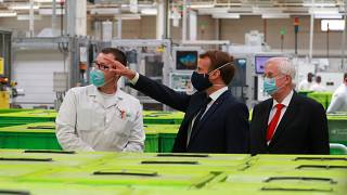 Emmanuel Macron visits a factory of manufacturer Valeo in Etaples