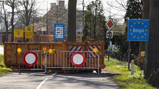 A container and barriers block a road on the Netherlands border with Belgium on March 23, 2020.