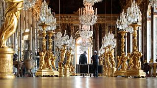 Workers in the Hall of Mirrors, cleaning 357 mirrors and decoration