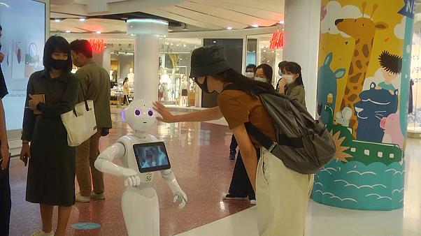 "Shopper interacting with ""PP"" robot"