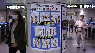 A poster on precautions against the new coronavirus is displayed at a subway station in Seoul, South Korea, Thursday, May 28, 2020.