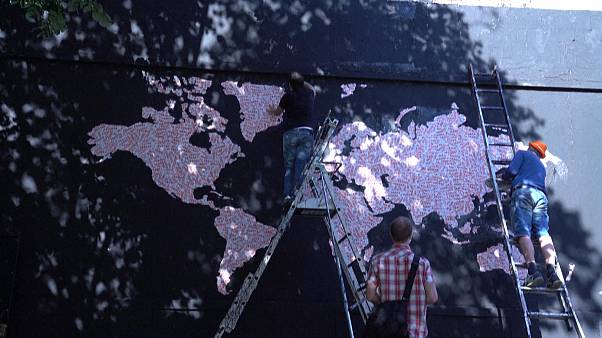 "Map of Europe made up of ""Fragile"" stickers being prepared by street artist Ender"