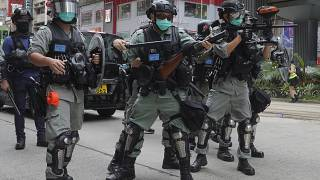 Hong Kong riot police fire tear gas as hundreds of protesters march against Beijing's national security legislation in Hong Kong, Sunday, May 24, 2020.