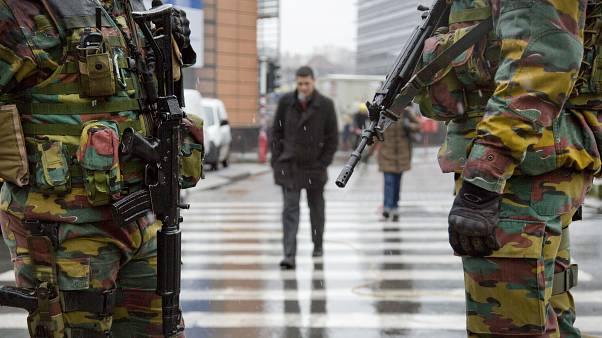 Belgian soldiers patrol in front of EU headquarters in Brussels on Monday, Jan. 19, 2015.