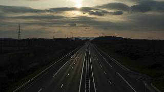 An empty highway is pictured outside Lyon, central France, Sunday, March 22, 2020. (AP Photo/Laurent Cipriani)