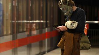 A man wearing a gas mask in Prague, Czech Republic