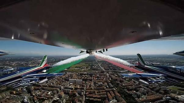 Acrobatic air force unit flying over Codogno with Italy's flag tricolour smoke