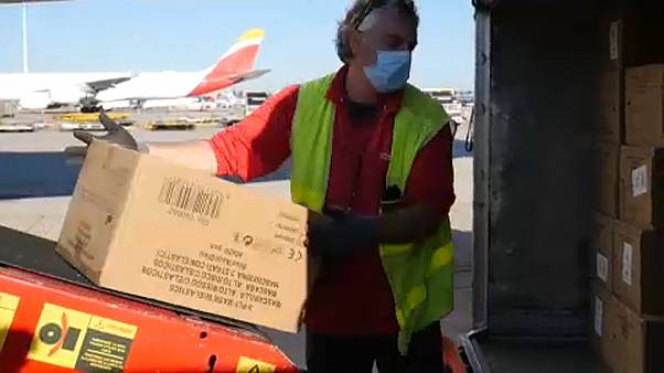 Air crew at Madrid airport unloading coronavirus aid from Shanghai