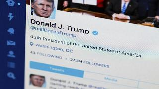 This April 3, 2017, file photo shows U.S. President Donald Trump's Twitter feed on a computer screen in Washington. President Donald Trump is claiming that Twitter has removed
