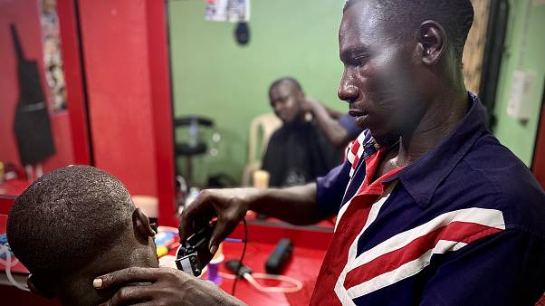 James, 30, has been helped to reintegrate into life in Nigeria after returning home from Libya. The IOM helped him to open a barbershop in Benin City, Edo State, Nigeria.