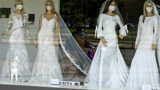 wedding dress store with mannequins wearing face masks