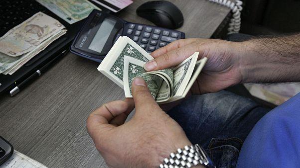 Currency exchange bureau worker, Tehran, Iran