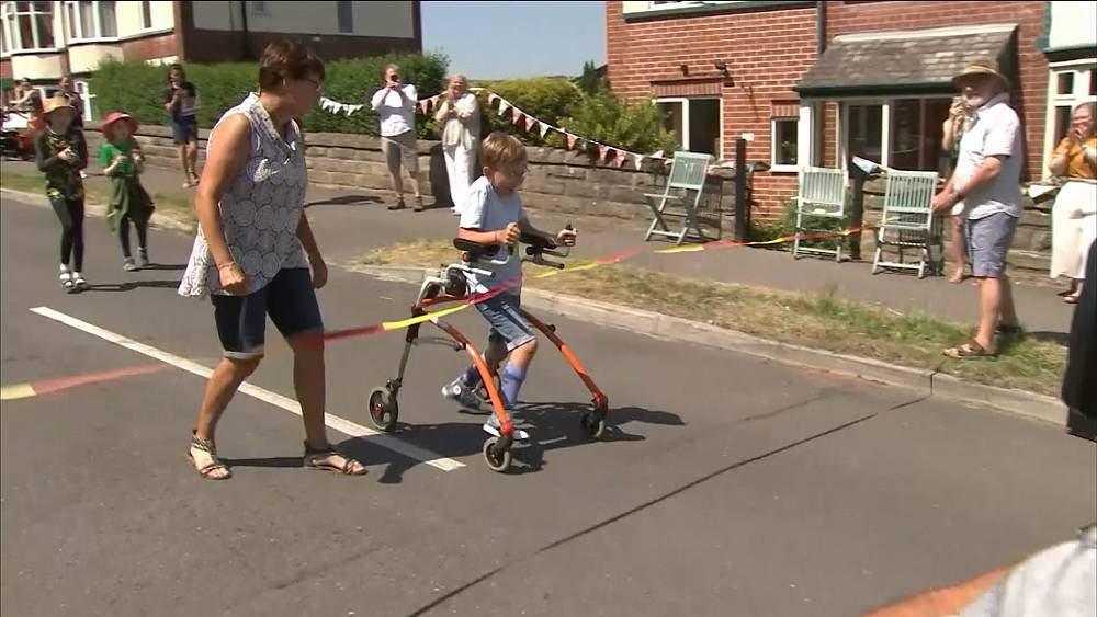Nine-year-old British boy with cerebral palsy completes marathon charity walk