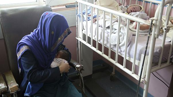 A mother breastfeeds her two-day-old baby at the Ataturk Children's Hospital, Kabul