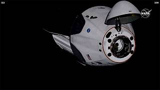 SpaceX Dragon crew capsule, with NASA astronauts, docks with the International Space Station