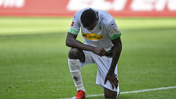 Moenchengladbach's Marcus Thuram taking the knee after scoring his side's second goal during the Bundesliga soccer match between Borussia Moenchengladbach and Union Berlin.