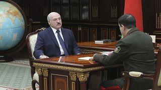 FILE: Belarusian President Alexander Lukashenko, left, meets with Valery Vakulchik, chief of the Belarusian state security service, KGB, in Minsk, Belarus, June 1, 2020.