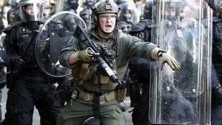 Police begin to clear demonstrators in Washington.