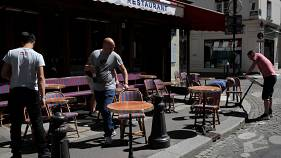 Waiters prepare the terrace of a restaurant in Paris ahead of reopening on June 2