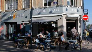 People enjoy sitting at a cafe terace in Lille