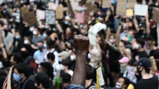 """Protesters demonstrate on June 2, 2020, during a """"Black Lives Matter"""" protest in New York City. Anti-racism protests have put several US cities under curfew to suppress riots"""
