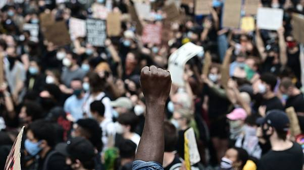 "Protesters demonstrate on June 2, 2020, during a ""Black Lives Matter"" protest in New York City. Anti-racism protests have put several US cities under curfew to suppress riots"