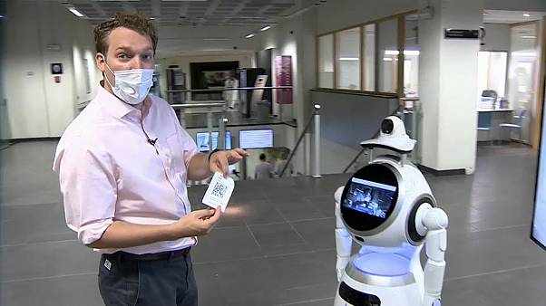 Euronews correspondent Jack Parrock trying out the Cruzr Health robot at the Antwerp University Hospital.